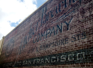 Historic brick sign from previous site at rear of Anchor brewery, San Francisco.
