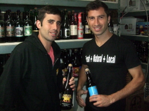 Sid (left) and Omar Mikhail displaying some of the hidden treasures of their cellar.