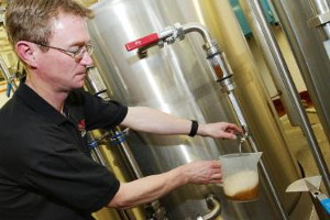 Bill Dobson taking a sample from the Brains Craft Brewery. Pic: Brains.