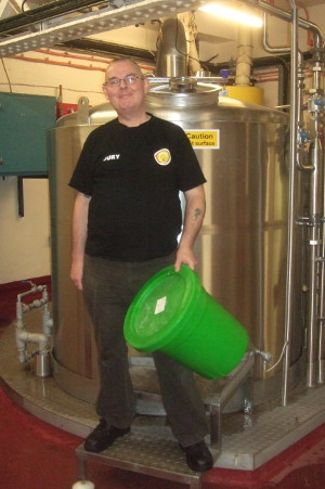 Your author and co-brewer with a bucket recently empty for late hopping in the last 10 minutes of the boil.