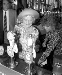 Elizabeth Bowes-Lyon, the Queen Mother, pulls a pint of Young's 'Ordinary' at the Queens Head, Stepney, in 1987.