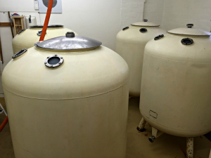 Fermentation vessels at Sarah Hughes brewery: old pub beer tanks.